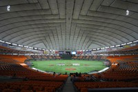 In this June 19, 2020, file photo, players gather in the empty stands prior to a baseball game between the Yomiuri Giants and the Hanshin Tigers at the Tokyo Dome in Tokyo. Japan's professional baseball and soccer leagues will begin allowing fans this week, the head of both leagues said on July 6, 2020. (AP Photo/Eugene Hoshiko)