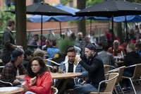 Members of the public are seen at a bar on Canal Street in Manchester's gay village, the U.K., on July 4, 2020. (AP Photo/Jon Super)