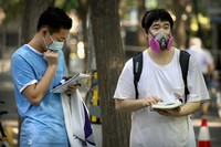 Students wearing face masks do some last-minute studying before the first day of China's national college entrance examinations, known as the gaokao, in Beijing, on July 7, 2020. (AP Photo/Mark Schiefelbein)