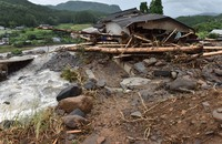 A home is seen damaged after being struck by logs and rocks carried by floodwater, in the town of Kokonoe in the southwestern Japan prefecture of Oita at 4:04 p.m. on July 7, 2020. (Mainichi/Kimiya Tanabe)