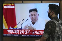 A South Korean army soldier passes by a TV showing a file image of North Korean leader Kim Jong Un during a news program at the Seoul Railway Station in Seoul, South Korea, on June 24, 2020. (AP Photo/Ahn Young-joon)