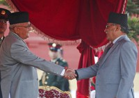 In this Feb. 15, 2018 file photo, Nepal's Prime Minister Khadga Prasad Oli, left, shakes hand with the chairman of Communist Party of Nepal (Maoist Centre) Pushpa Kamal Dahal after taking the oath of office at the Presidential building in Kathmandu, Nepal. (AP Photo/Niranjan Shrestha)