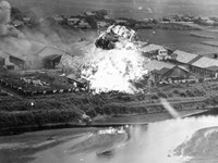 A complex that appears to be a military equipment factory on the banks of the Iseri River in the city of Kumamoto is seen being bombed in this image owned by Takao Imayoshi and William J. Swain, provided by Kazuo Takatani, representative of the Kumamoto War-site and Cultural Heritage Network.