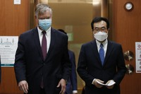 U.S. Deputy Secretary of State Stephen Biegun, left, walks with his South Korean counterpart Lee Do-hoon after their meeting at the Foreign Ministry in Seoul, on July 8, 2020. (Kim Hong-ji/Pool Photo via AP)