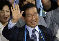 In this June 5, 2014 file photo, Park Won-soon, then candidate for Seoul city mayor of the main opposition party New Politics Alliance for Democracy celebrates his victory in the Seoul mayoral election at his office in Seoul, South Korea. (AP Photo/Lee Jin-man)