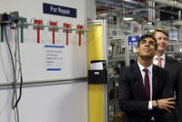 Britain's Chancellor of the Exchequer Rishi Sunak visits the Worcester Bosch factory to promote the initiative, Plan for Jobs, in Worcester, England, on July 9, 2020. (Phil Noble/Pool via AP)