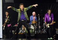 Ron Wood, from left, Mick Jagger, Charlie Watts and Keith Richards of the Rolling Stones perform during their concert in Pasadena, Calif. (Photo by Chris Pizzello/Invision/AP)
