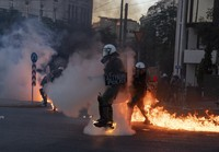Riot police officers try to avoid patrol bombs thrown by protesters outside the Greek Parliament during a protest against new protest law in Athens, on July 9, 2020. (AP Photo/Petros Giannakouris)