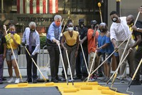 Mayor Bill de Blasio, third from left, participates in painting Black Lives Matter on Fifth Avenue in front of Trump Tower, on July 9, 2020, in New York. (AP Photo/Mark Lennihan)