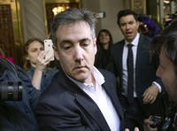 In this May 6, 2019, file photo, Michael Cohen, former attorney to President Donald Trump, leaves his apartment building before beginning his prison term in New York. (AP Photo/Kevin Hagen)