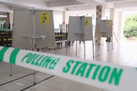 In this handout photo provided by the Ministry of Communications and Information, polling stations have been set up at Chung Cheng high school, on July 9, 2020 in Singapore. (Singapore Ministry of Communications and Information via AP)