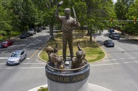 Traffic passes by the statue of tennis star Arthur Ashe on Monument Avenue, on July 10, 2020, in Richmond, Va. (AP Photo/Steve Helber)