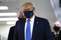 President Donald Trump wears a mask as he walks down the hallway during his visit to Walter Reed National Military Medical Center in Bethesda, Md., on July 11, 2020. (AP Photo/Patrick Semansky)