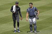 New York Yankees relief pitcher Aroldis Chapman, left, leaves the field with catcher Gary Sanchez after a bullpen session during a baseball summer training camp workout, on July 5, 2020, at Yankee Stadium in New York. (AP Photo/Kathy Willens)