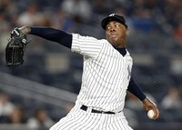 In this June 24, 2019 file photo, New York Yankees closer Aroldis Chapman winds up in the ninth inning of a baseball game against the Toronto Blue Jays in New York. (AP Photo/Kathy Willens)