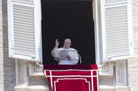 Pope Francis delivers his blessing to faithful during the Angelus prayer from the window of his studio overlooking St. Peter's Square at the Vatican, on July 12, 2020. (AP Photo/Alessandra Tarantino)