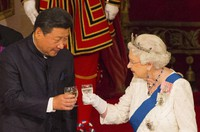 In this Oct. 20, 2015 file photo, Chinese President Xi Jinping with Britain's Queen Elizabeth II during a state banquet at Buckingham Palace, London, on the first day of the state visit to Britain. (Dominic Lipinski/Pool Photo via AP)