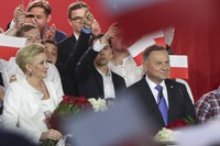 Incumbent President Andrzej Duda, right, smiles next to his wife Agata Kornhauser-Duda while addressing supporters in Pultusk, Poland, on July 12, 2020. (AP Photo/Czarek Sokolowski)