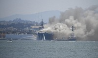 Smoke rises from the USS Bonhomme Richard at Naval Base San Diego on July 12, 2020, in San Diego after an explosion and fire Sunday on board the ship at Naval Base San Diego. (AP Photo/Denis Poroy)