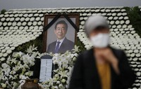 A mourner passes by a memorial altar for late Seoul Mayor Park Won-soon at City Hall Plaza in Seoul, South Korea, on July 13, 2020. Mayor Park was found dead in wooded hill in northern Seoul on Friday after massive police searches for him. (AP Photo/Lee Jin-man)