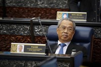 Prime Minister Muhyiddin Yassin attending parliament session at parliament lower house in Kuala Lumpur, Malaysia, on July 13, 2020. (AP Photo/Vincent Thian)