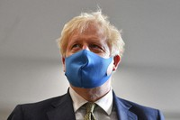 Britain's Prime Minister Boris Johnson, wearing a face mask, visits the headquarters of the London Ambulance Service NHS Trust in London, on July 13, 2020. (Ben Stansall/Pool via AP)