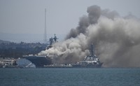 Smoke rises from the USS Bonhomme Richard at Naval Base San Diego, on July 12, 2020, in San Diego after an explosion and fire Sunday on board the ship at Naval Base San Diego. (AP Photo/Denis Poroy)