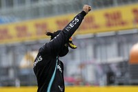 Mercedes driver Lewis Hamilton of Britain reacts on the podium after winning the Styrian Formula One Grand Prix race at the Red Bull Ring racetrack in Spielberg, Austria, on July 12, 2020. (Leonhard Foeger/Pool via AP)