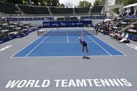 Springfield Laser tennis player Olga Govortsova delivers a serve during the World TeamTennis tournament at The Greenbrier resort on July 12, 2020, in White Sulphur Springs, W.Va. (AP Photo/Steve Helber)