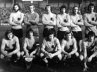 In this Feb. 21, 1974 file photo, the Dutch National team line up, who are to take part in the World Soccer Cup Final in West Germany in 1974, in Amsterdam, the Netherlands. The players are, standing, from left; Barry Hulshoff; Plot Schrijvers; Aad Mansveld; Wim Suurbier; Johan Neeskens and Ruud Krol. Foreground, from left; Arie Haan; Johan Cruyff; Gerry Muhren; Johrant Rep. and Rob Rensenbrink. Wim Suurbier, the dependable right back of Ajax and Dutch national teams of the 1970s, has died, his former club announced on July 13, 2020. He was 75. (AP Photo)