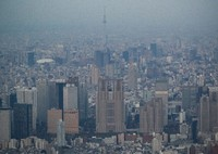 The Tokyo Metropolitan Government building, center, and other high-rise buildings are seen in Tokyo's Shinjuku Ward in this photo taken from a Mainichi Shimbun helicopter in April 2020. (Mainichi/Kota Yoshida)
