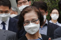 Lee Myung-hee, the widow of former Korean Air Chairman Cho Yang-ho leaves the Seoul Central District Court in Seoul, South Korea, on July 14, 2020.  (AP Photo/Ahn Young-joon)