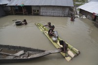 Flood affected villagers are seen near their partially submerged houses in Gagolmari village, Morigaon district, Assam, India, on July 14, 2020. (AP Photo/Anupam Nath)