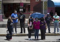 Relatives of Mexican citizens who died from COVID-19 complications in the United States attend a ceremony for their loved ones in Puebla, Mexico, on July 13, 2020. (AP Photo/Fernando Llano)