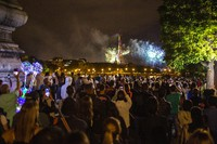 People attend the fireworks display by the Eiffel Tower in Paris during Bastille Day celebrations late on July 14, 2020. Bastille Day marks the July 14, 1789, storming of the Bastille prison by angry Paris crowds that helped spark the French Revolution. (AP Photo/Rafael Yaghobzadeh)