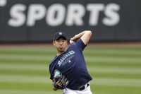 In this July 3, 2020 photo, Seattle Mariners pitcher Yusei Kikuchi throws the ball at a baseball practice in Seattle. (AP Photo/Elaine Thompson)