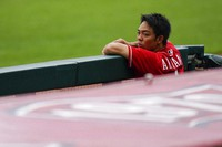 Cincinnati Reds center fielder Shogo Akiyama watches team baseball practice from the dugout at Great American Ballpark in Cincinnati, on July 10, 2020. (AP Photo/Bryan Woolston)
