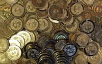 This April 3, 2013, file photo shows bitcoin tokens in Sandy, Utah. (AP Photo/Rick Bowmer)