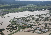 Farmland and buildings inundated with floodwater from the overflowed Mogami River are seen in the city of Murayama, Yamagata Prefecture, in this image taken on July 29, 2020, from a Mainichi Shimbun aircraft. (Mainichi/Yuki Miyatake)