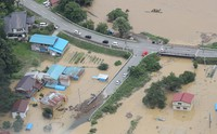 Housing in the village of Okura, Yamagata Prefecture, that was flooded after the Mogami River overflowed is seen on July 29, 2020, in this image taken from a Mainichi Shimbun aircraft. (Mainichi/Yuki Miyatake)
