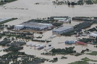 Farming facilities and other buildings are seen flooded after the Mogami River overflowed in the city of Murayama, Yamagata Prefecture, on July 29, 2020, in this image taken from a Mainichi Shimbun aircraft. (Mainichi/Yuki Miyatake)