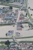 Homes in Oishida, Yamagata Prefecture, are seen flooded on July 29, 2020, after the Mogami River overflowed, in this image taken from a Mainichi Shimbun aircraft. (Mainichi/Yuki Miyatake)