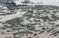 Farmland and buildings are seen flooded on July 29, 2020, in the city of Murayama, Yamagata Prefecture, after the Mogami River overflowed, in this image taken from a Mainichi Shimbun aircraft. (Mainichi/Yuki Miyatake)
