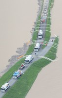 Work to drain floodwater from a residential area is seen being done using specialized vehicles, in this image taken from a Mainichi aircraft in the village of Okura, Yamagata Prefecture, on July 29, 2020. (Mainichi/Yuki Miyatake)