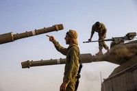 Israeli soldiers work on tanks in the Israeli controlled Golan Heights near the border with Syria, not far from Lebanon border, on July 28, 2020. (AP Photo/Ariel Schalit)