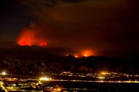The Apple Fire burns behind mountains near Beaumont, Calif., on Aug. 2, 2020. (AP Photo/Ringo H.W. Chiu)
