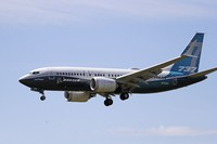 A Boeing 737 MAX jet heads to a landing at Boeing Field following a test flight on June 29, 2020, in Seattle. (AP Photo/Elaine Thompson)