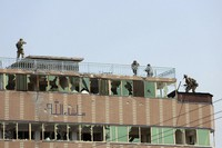 Afghan security personnel take position on the top of a building where insurgents were hiding, in the city of Jalalabad, east of Kabul, Afghanistan, on Aug. 3, 2020. (AP Photo/Rahmat Gul)