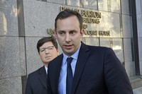 In this Sept. 24, 2019 file photo, former Google engineer Anthony Levandowski speaks to the media, as his attorney Miles Ehrlich stands behind him outside of a federal courthouse in San Francisco. (AP Photo/Michael Liedtke)