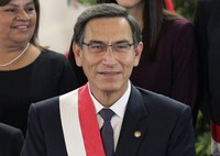 In this Oct. 3, 2019 file photo, Peru's President Martin Vizcarra smiles after the swearing-in ceremony of his new cabinet at the government palace in Lima, Peru. (AP Photo/Martin Mejia)